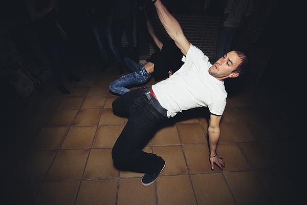 Friends dancing in nightclub Photograph by Inuk Studio