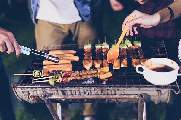 Friends Preparing Food On Barbecue Grill At Night Photograph by Sumetee Theesungnern / EyeEm
