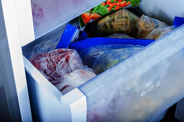 Frozen vegetables in freezer Photograph by Artursfoto