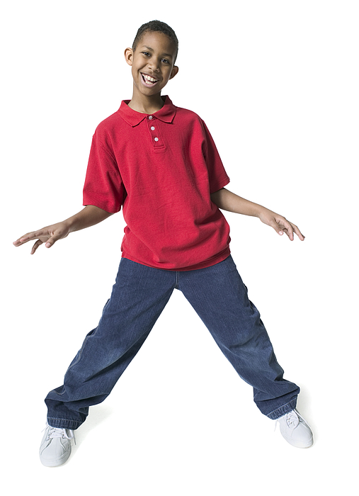 Full Body Shot Of A Male Child As He Spreads Out His Arms And Dances Photograph by Photodisc