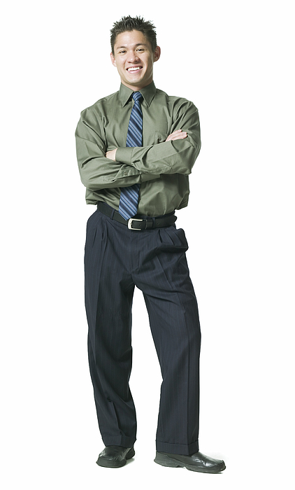 Full Body Shot Of A Young Adult Business Man In A Green Shirt As He Folds His Arms And Smiles Photograph by Photodisc