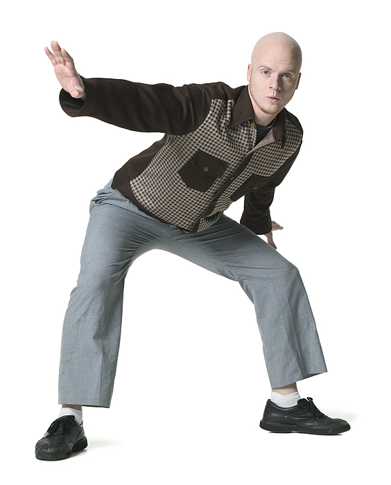 Full Body Shot Of A Young Adult Male In A Brown Checkered Shirt As He Strikes A Silly Pose Photograph by Photodisc
