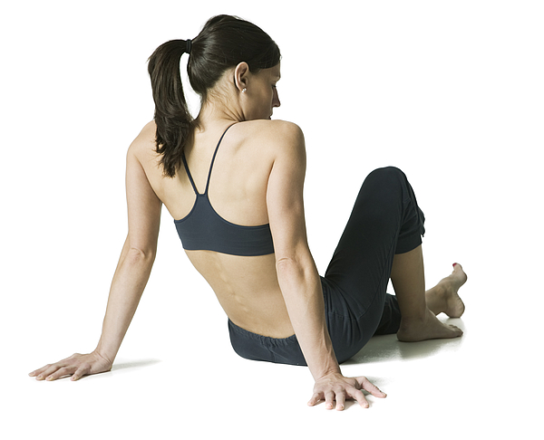 Full Body Shot Of A Young Adult Woman In A Black Workout Outfit As She Sits And Relaxes Photograph by Photodisc