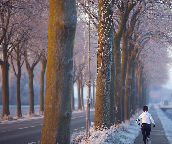 Full Length Of A Woman Running On Footpath In City Photograph by Paulien Tabak / EyeEm