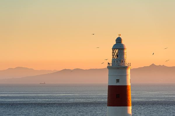 Gibraltar Lighthouse at sunset Photograph by © Allard Schager