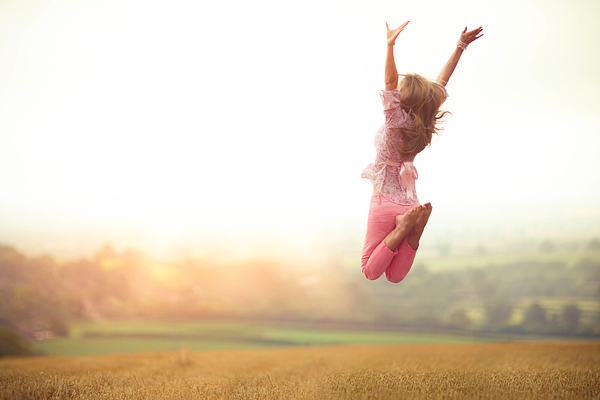 Girl Jumping in Harvested Wheat Field Photograph by Olivia Bell Photography