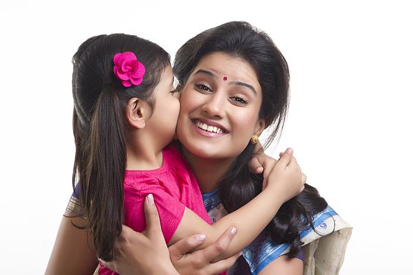 Girl kissing her mother on the cheek Photograph by Sudipta Halder