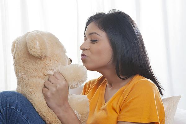Girl kissing teddy bear Photograph by Ravi Ranjan