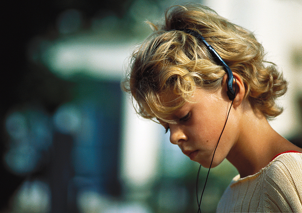 Girl Listening To Headphones Photograph by Laurence Mouton