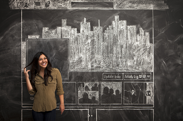 Girl smiles in front of facebook chalkboard Photograph by Justin Lewis