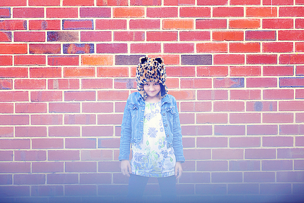 Girl Wearing a Hat Against A Brick Wall Photograph by Little Brown Rabbit Photography
