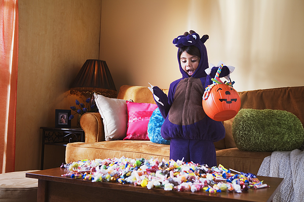 Girl with Halloween candy Photograph by Jupiterimages