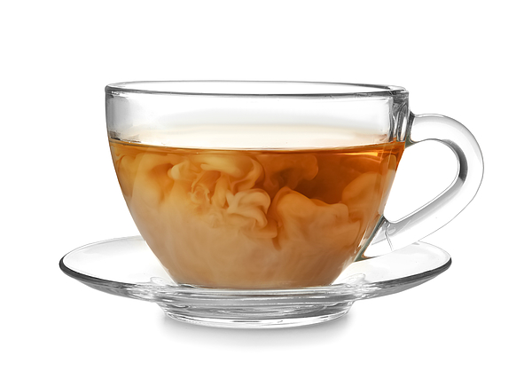Glass cup with black tea and milk on white background Photograph by Belchonock