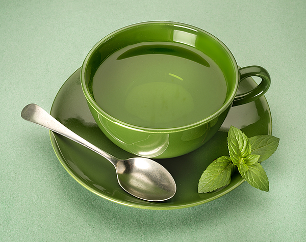 Green Tea On Green Background Photograph by ATU Images