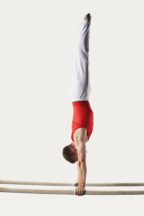 Gymnast Doing Handstand On Parallel Bars Photograph by Fuse