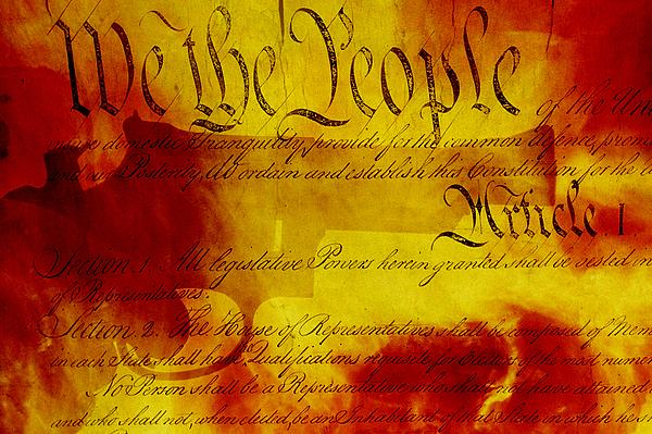 Handgun, USA Constitution, fiery background. Photograph by Harald Sund