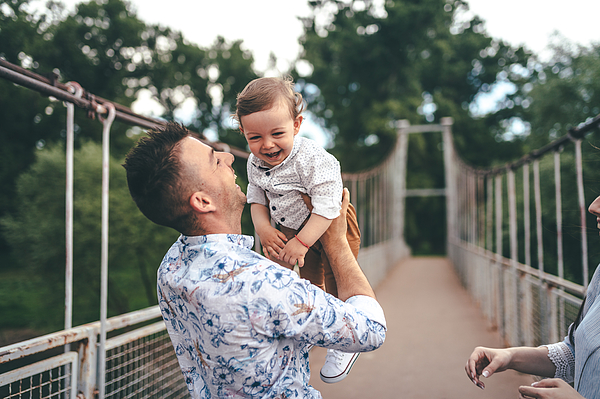 Happy Photo Father And Child Having Fun Outdoors Photograph by PhotoAttractive