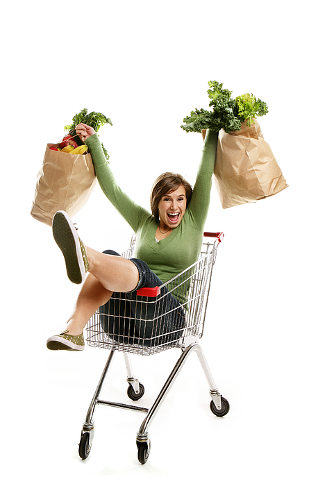 Happy Young woman with her grocery bags Photograph by Lisegagne