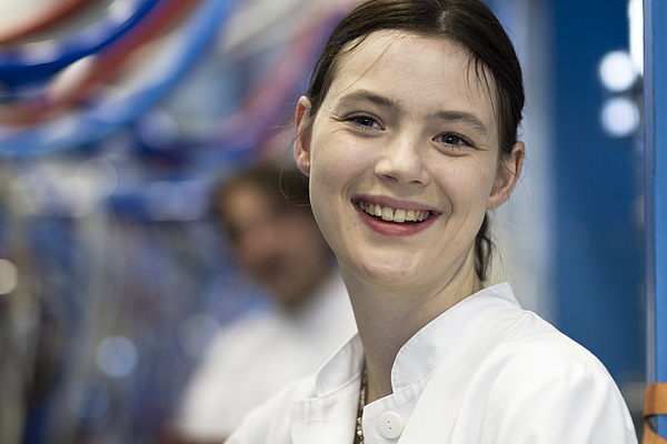 Head and shoulders of your woman wearing lab coat looking at camera smiling Photograph by Sigrid Gombert