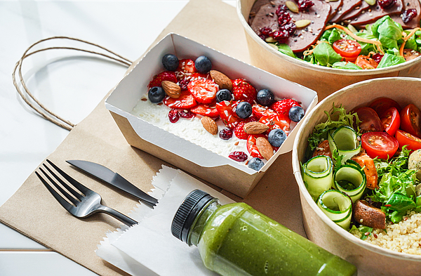 Healthy meal slimming diet plan daily ready menu background, organic fresh dishes and smoothie, fork knife on paper eco bag as food delivery courier service at home in office concept, close up view. Photograph by Insta_photos