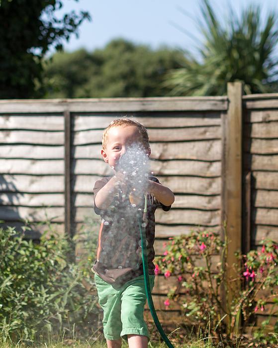 Heatwave - Watering the Garden Photograph by s0ulsurfing - Jason Swain