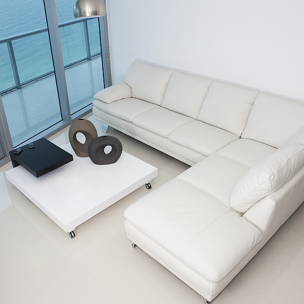 High angle view of sofa and coffee table in modern living room Photograph by Camilo Morales