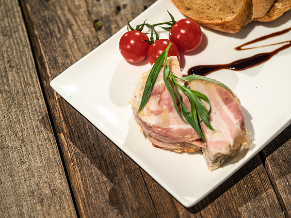 High Angle View Of Terrine With Bacon And Tomatoes In Plate On Wooden Table Photograph by Igor Golovniov / EyeEm