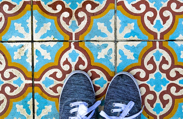 High Section Of Person On Tiled Floor Photograph by Rosario Amor / EyeEm