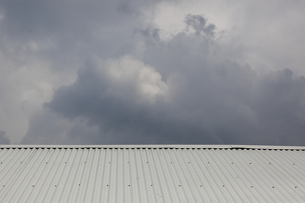 High Section Of Rooftops Against Clouds Photograph by Paulien Tabak / EyeEm