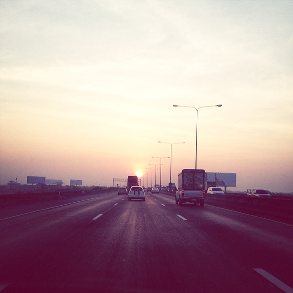 Highway During Sunset Photograph by Tatthon Piyaratmanont / EyeEm
