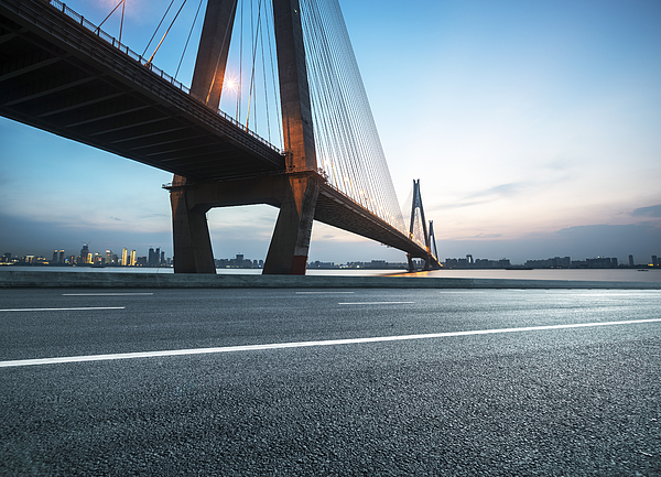 Highway near bridge in dusk for car commercialn Photograph by Xvision
