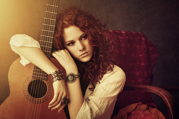 Hippie Girl Embracing Her Acoustic Guitar Photograph by Mammuth