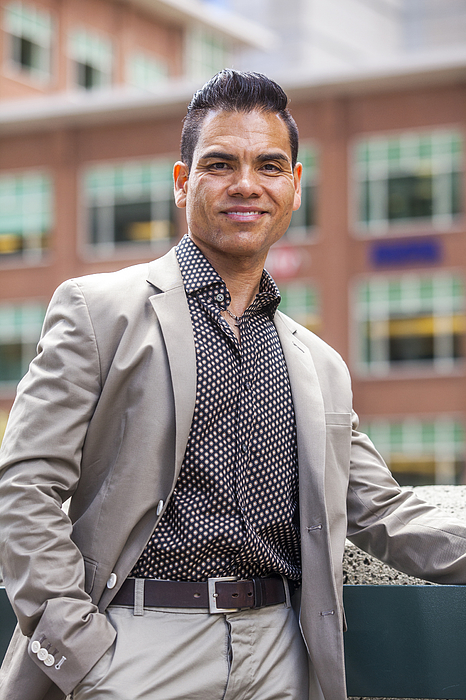 Hispanic businessman smiling outdoors Photograph by Adam Hester