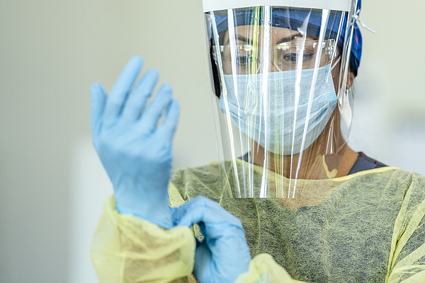 Hispanic female medical professional in Personal Protective Equipment Photograph by FatCamera