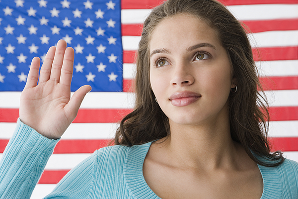 Hispanic teenaged girl in front of American flag Photograph by Jose Luis Pelaez Inc