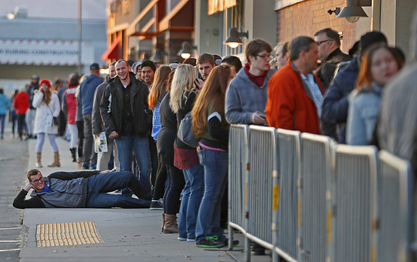 Holiday Shoppers Get An Early Start On Thanksgiving Day Photograph by George Frey