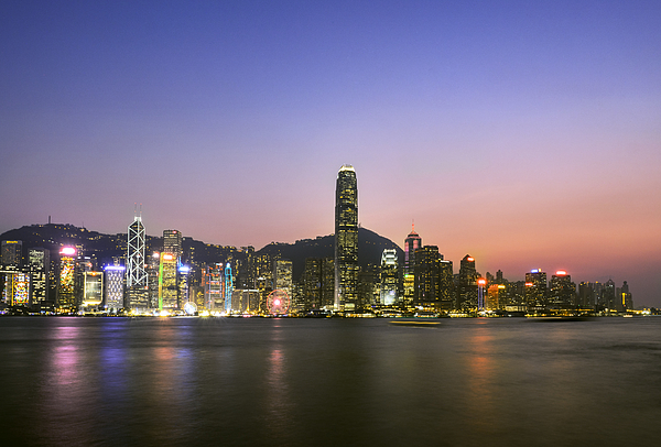 Hong Kong Skyline at dusk Photograph by Bernd Schunack