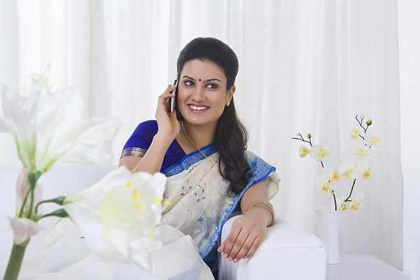 Housewife talking on a mobile phone Photograph by Sudipta Halder