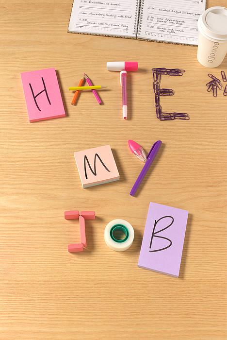 I hate my job office desk Photograph by Peter Dazeley