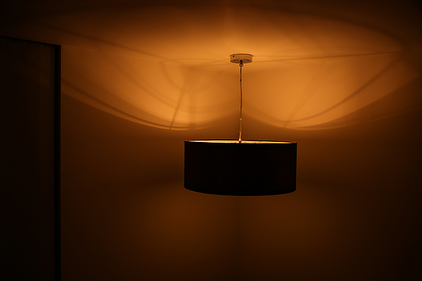 Illuminated Lighting Equipment Hanging In Room At Home Photograph by Alessandro Miccoli / EyeEm
