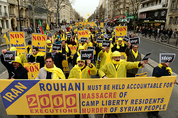 Iranian Dissidents Demonstrate Against The Visit Of Iranian President Rouhani In Paris Photograph by Frederic Stevens