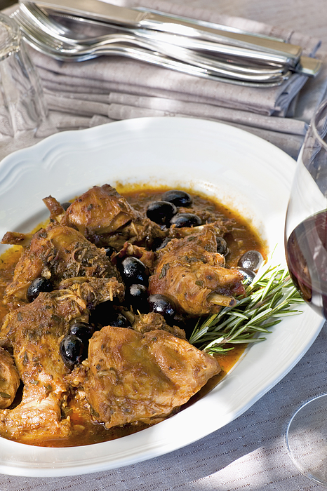 Italian coniglio e olive or rabbit and olives Photograph by John Rizzo