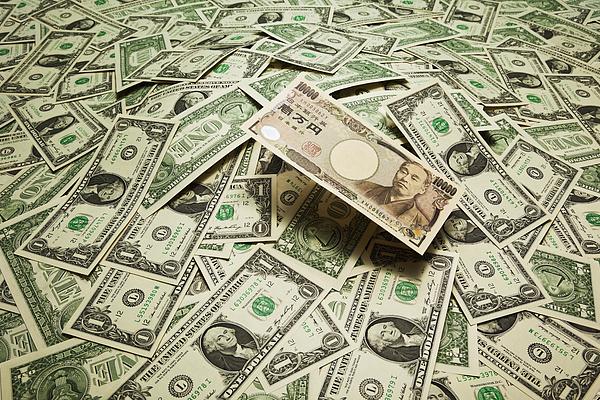 japan yen  on the  US dollar banknotes Photograph by Yuji Sakai