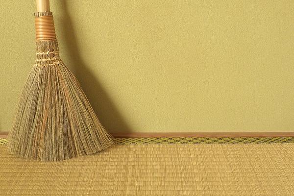 Japanese traditional mud wall, tatami matting and broom Photograph by Sotopiko