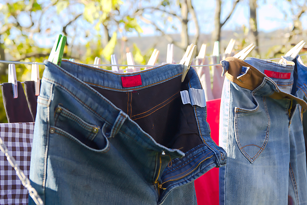 Jeans Trousers Laundry Drying Outdoors Photograph by YesKatja