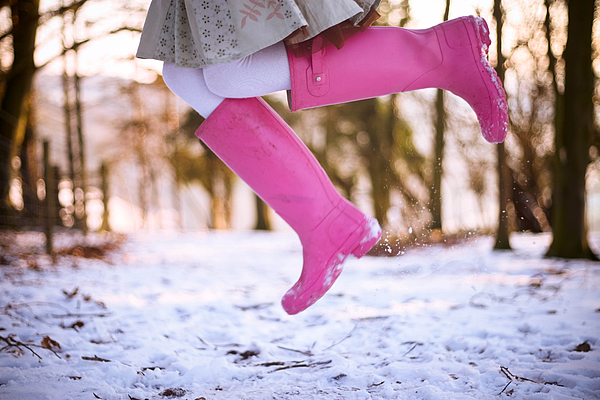 Jumping with pink boots Photograph by Olivia Bell Photography