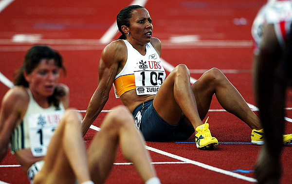 Kelly Holmes of Great Britain sits on the track Photograph by Jamie McDonald