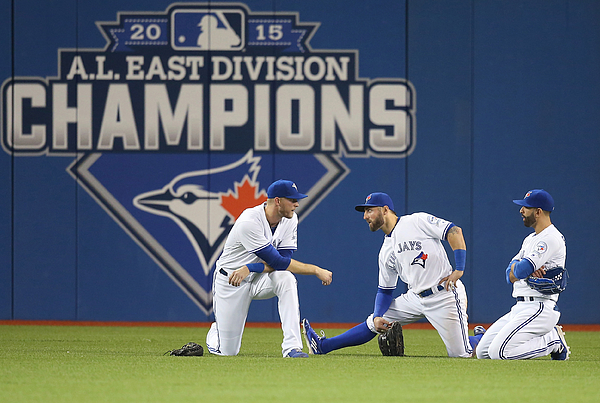 Kevin Pillar and Michael Saunders Photograph by Tom Szczerbowski