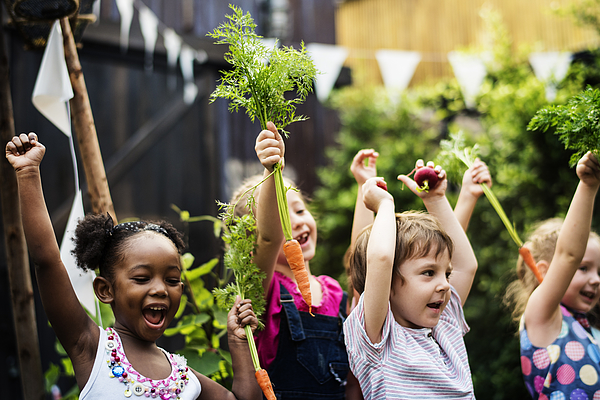 Kids in a vegetable garden with carrot Photograph by Rawpixel