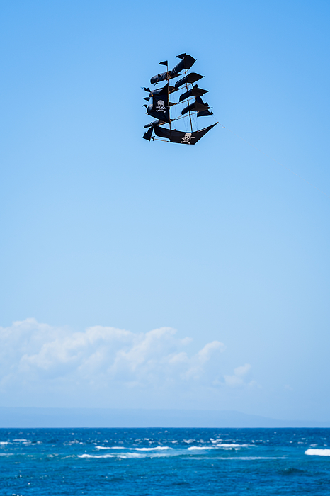 Kite in the clear sky of Bali Photograph by Mauro Tandoi